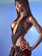 Black dress. Ebony tranny Natassia Dreams posing in black lascivious dress