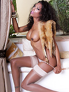 Window seat Seductive ebony shemale Natassia posing.